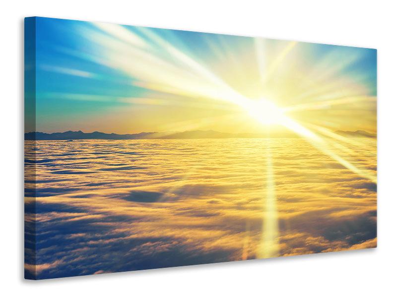 Leinwandbild Sonnenuntergang über den Wolken